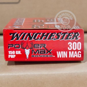 A photograph of 20 rounds of 150 grain 300 Winchester Magnum ammo with a HP bullet for sale.