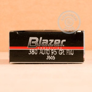 A photograph detailing the .380 Auto ammo with FMJ bullets made by Blazer.