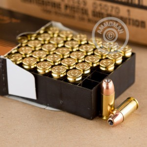 A photograph of 1000 rounds of 115 grain 9mm Luger ammo with a JHP bullet for sale.