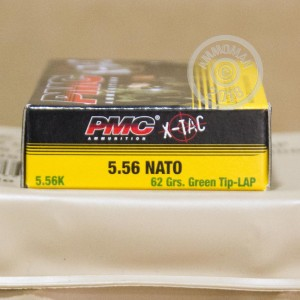 An image of 5.56x45mm ammo made by PMC at AmmoMan.com.