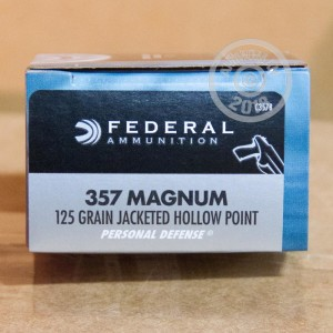 A photograph of 20 rounds of 125 grain 357 Magnum ammo with a JHP bullet for sale.