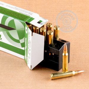 A photograph detailing the 223 Remington ammo with metal case bullets made by Remington.