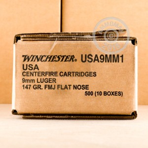 A photograph of 500 rounds of 147 grain 9mm Luger ammo with a FMJ bullet for sale.