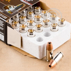 A photograph detailing the 9mm Luger ammo with JHP bullets made by Winchester.