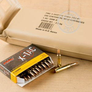 A photograph of 200 rounds of 55 grain 5.56x45mm ammo with a FMJ bullet for sale.