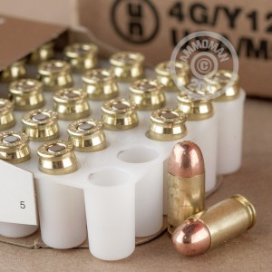 A photograph detailing the .380 Auto ammo with FMJ bullets made by Blazer Brass.