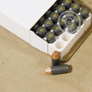A photograph detailing the .45 Automatic ammo with FMJ bullets made by Hornady.