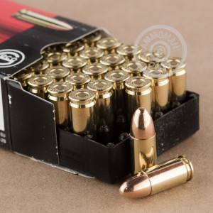 A photograph detailing the 9mm Luger ammo with FMJ bullets made by GECO.