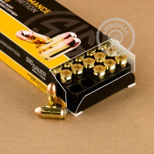 A photograph detailing the .45 Automatic ammo with FMJ bullets made by SIG.