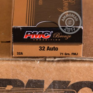 A photograph detailing the .32 ACP ammo with FMJ bullets made by PMC.