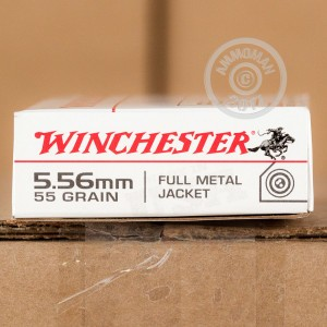 A photograph of 20 rounds of 55 grain 5.56x45mm ammo with a FMJ bullet for sale.