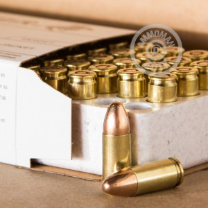 A photograph of 500 rounds of 124 grain 9mm Luger ammo with a FMJ bullet for sale.
