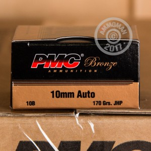 A photograph detailing the 10mm ammo with JHP bullets made by PMC.