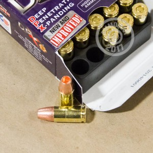 A photograph of 20 rounds of 115 grain 9mm Luger ammo with a JHP bullet for sale.