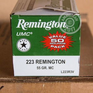 A photograph of 50 rounds of 55 grain 223 Remington ammo with a metal case bullet for sale.