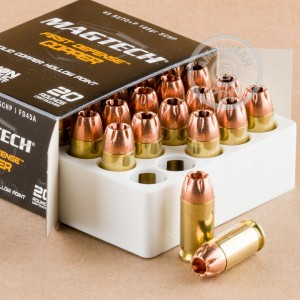 A photograph of 20 rounds of 165 grain .45 Automatic ammo with a JHP bullet for sale.