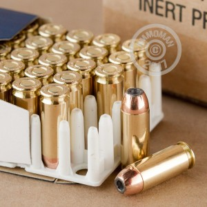 A photograph of 500 rounds of 180 grain 10mm ammo with a JHP bullet for sale.