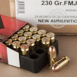 A photograph detailing the .45 Automatic ammo with FMJ bullets made by Black Hills Ammunition.