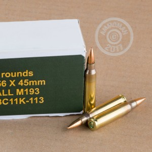 A photograph of 1000 rounds of 55 grain 5.56x45mm ammo with a FMJ-BT bullet for sale.