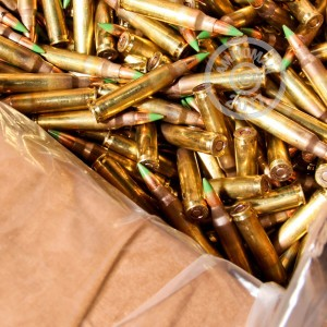 A photograph of 2000 rounds of 62 grain 5.56x45mm ammo with a FMJ bullet for sale.