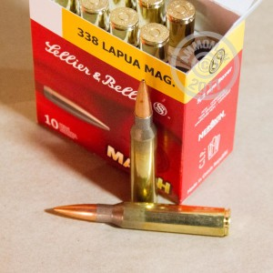 A photograph detailing the 338 Lapua Magnum ammo with Hollow-Point Boat Tail (HP-BT) bullets made by Sellier & Bellot.