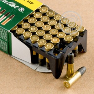 Photograph of .22 Long Rifle ammo with HP ideal for hunting varmint sized game, training at the range.