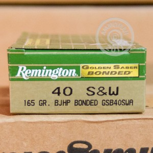 A photograph detailing the .40 Smith & Wesson ammo with JHP bullets made by Remington.