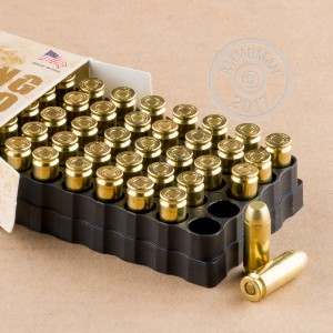 An image of 10mm ammo made by Team Never Quit at AmmoMan.com.