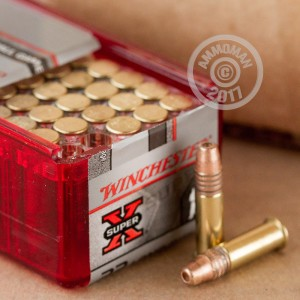 Photograph of .22 Long Rifle ammo with copper plated hollow point ideal for hunting varmint sized game, training at the range.