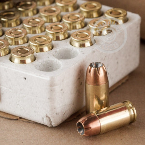 A photograph detailing the .380 Auto ammo with JHP bullets made by Winchester.