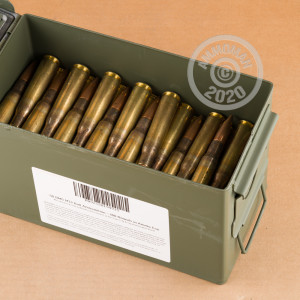 A photograph of 100 rounds of 660 grain .50 BMG ammo with a FMJ bullet for sale.