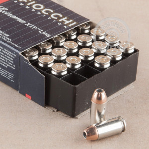 A photograph of 25 rounds of 155 grain .40 Smith & Wesson ammo with a XTP bullet for sale.