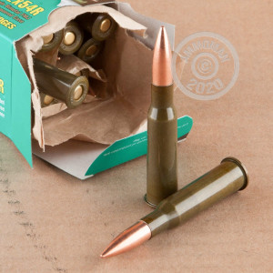 A photograph of 20 rounds of 174 grain 7.62 x 54R ammo with a FMJ bullet for sale.