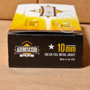 A photograph of 1000 rounds of 180 grain 10mm ammo with a FMJ bullet for sale.