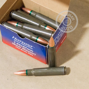 A photograph of 20 rounds of 170 grain 8mm Mauser JS ammo with a FMJ bullet for sale.