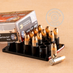 A photograph of 20 rounds of 135 grain 9mm Luger ammo with a JHP bullet for sale.