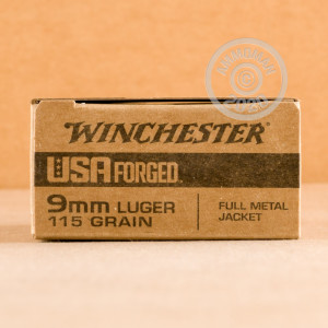 A photograph detailing the 9mm Luger ammo with FMJ bullets made by Winchester.