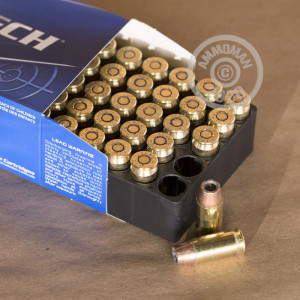 A photograph detailing the .45 Automatic ammo with JHP bullets made by Magtech.