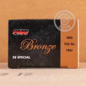 A photograph detailing the 38 Special ammo with FMJ bullets made by PMC.