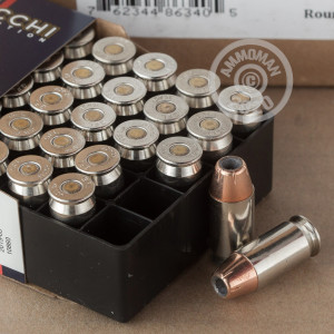A photograph of 25 rounds of 200 grain .45 Automatic ammo with a XTP Mag bullet for sale.