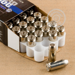 A photograph detailing the .40 Smith & Wesson ammo with expanding full metal jacket bullets made by Federal.