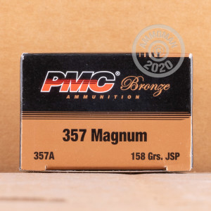 A photograph of 50 rounds of 158 grain 357 Magnum ammo with a Jacketed Soft-Point (JSP) bullet for sale.
