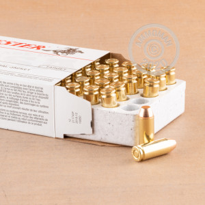 A photograph detailing the 10mm ammo with FMJ bullets made by Winchester.