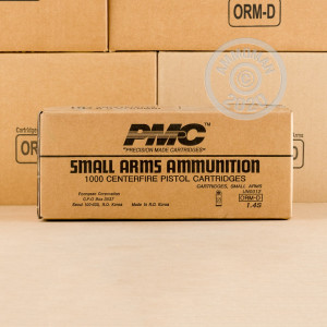 A photograph detailing the .380 Auto ammo with FMJ bullets made by PMC.