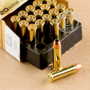 A photograph of 20 rounds of 140 grain 357 Magnum ammo with a JHP bullet for sale.