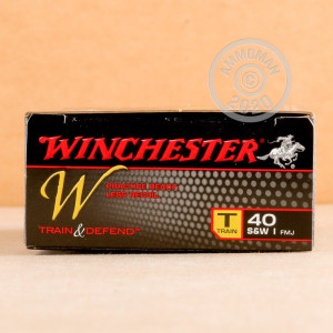 A photograph detailing the .40 Smith & Wesson ammo with FMJ bullets made by Winchester.
