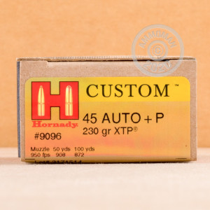 A photograph detailing the .45 Automatic ammo with JHP bullets made by Hornady.