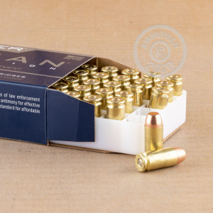 A photograph detailing the .40 Smith & Wesson ammo with TMJ bullets made by Speer.