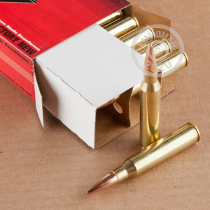 A photograph of 20 rounds of 250 grain 338 Lapua Magnum ammo with a Hollow-Point Boat Tail (HP-BT) bullet for sale.