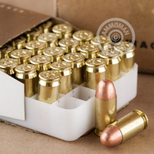 A photograph detailing the .45 Automatic ammo with FMJ bullets made by Blazer Brass.